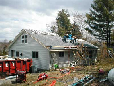 Dan Clark and Company install shingles